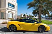Yellow Lamborghini luxury sports car outside the dental office at Breakwater, Abu Dhabi, United Arab Emirates