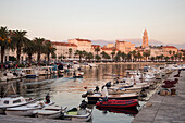 Fishing boats and waterfront with St. Dominius Cathedral in the late afternoon, Split, Split-Dalmatia, Croatia