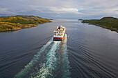 MS Midnatsol of the Hurtigruten going Sorth near Roervik, Naeroysundet, Province of North-Troendelag, Troendelag, Norway, Europe