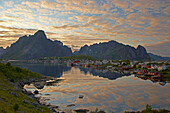View of the fishing village of Reine in the evening light, Lofoten, Isle of Moskenes, Province of Nordland, Nordland, Norway, Europe