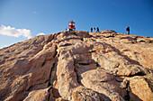 Lighthouse on rocks at Kap Lindesnes, Province of Vest-Agder, Soerlandet, Norway, Europe