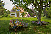 Lunch in the garden, Vaestra Bodarne, Province of Bohuslaen, West coast, Sweden, Europe