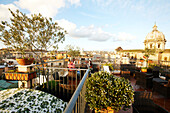 View from the terrace of Hotel de Fiori over the roofs of Rome towards the dome of St. Peters, Rome, Latio, Italy