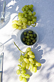 Grapes and olives on the table, Masseria, Alchimia, Apulia, Italy