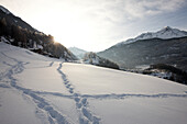 Footprints in the snow above Soelden, View to the South, Tyrol, Austria