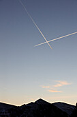 Two airplanes crossing paths in the evening sky, Mountains, Travel