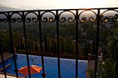 View from a balcony over the swimming pool towards the mountains, Mallorca, Balearic Islands, Spain