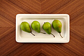 Four pears in a dish on a table, Fruit, Food