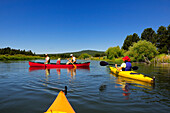 People kayaking and canoeing on a river Bend, Oregon, USA