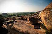 Male climber bouldering alone in vast boulderfield in Hampi, India Hampi, Karnataka, India