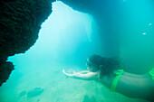 Female exlpores underwater ruins in Idaho Sandpoint, Idaho, USA