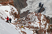 Mountaineers at 22, 400ft on the upper Canaleta near the summit of Aconcagua, at around 6800 meters elevation currently, Andes Mountain, Argentina, Mendoza, Andes Mountains, Argentina