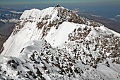 Aconcagua South Summit view and climbers ascending, from Aconcagua main summit at 6962 m Mendoza, Andes Mountains, Argentina