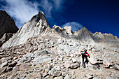 A female hiker scrambles up the mountaineer's route of Mount Whitney, California Lone Pine, California, United States of America