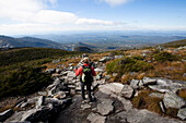 An athletic female hiker hikes the Franconia Ridge Trail Franconia, New Hampshire, United States of America