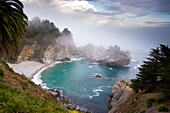 Fog rolls in at the classic Big Sur overlook in Julia Pfeiffer Burns State Park in California Big Sur, California, USA