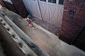 A teenage girl runs through an alleyway in downtown Birmingham, Alabama Birmingham, Alabama, United States