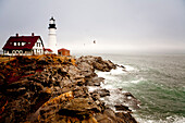Portland head light photographed late in the afternoon under fog in Maine Portland, Maine, USA