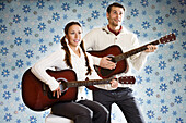 A mock Christmas album cover features a humorous young couple holding guitars Redmond, Washington, United States