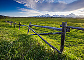 A ranching fence in Grand Teton National Park in late afternoon light, Wyoming Grand Teton National Park, Wyoming, USA