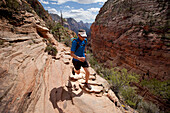 Man trail running in Zion Springdale, Utah, United States