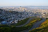 Golden afternoon light illuminates San Francisco as seen from Twin Peaks, CA., San Francisco, California, USA