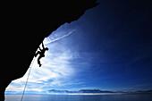 Man climbing against blue sky Lake Tahoe, Nevada, United States
