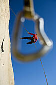 Rappel framed by quickdraw, Bishop, California, United States