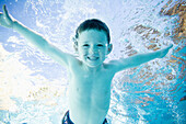 Young boy plays in a pool San Clemente, California, United States