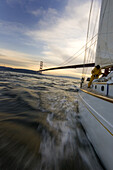 A man furls a sail on a yacht San Francisco, California, United States
