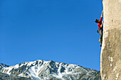 Man lead climbing, Bishop, California, United States
