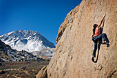Young woman rock climbing at the Buttermilks near Bishop, California Bishop, California, USA