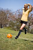 An athletic woman kicks a soccer ball Long Beach, California, United States