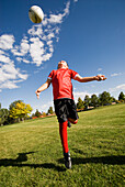 A boy does a header with the soccer ball in Fort Collins, Colorado Fort Collins, Colorado, USA