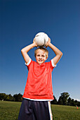 A boy gets ready to throw the soccer ball in Fort Collins, Colorado Fort Collins, Colorado, USA