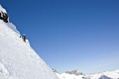 A young man skis untracked powder off-piste at St. Anton am Arlberg, Austria St. Anton am Arlberg, Arlberg, Austria