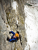 Woman on a via Ferrata, near Leysin, Switzerland