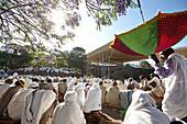 Visitors of the Sunday Mass near monolithic church Bete Medhane Alem, Church of St. George, Lalibela, Amhara region, Ethiopia