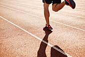 Male athlete running on a track, Seattle, WA