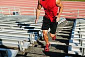 Male athlete running up steps, Seattle, WA