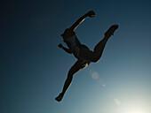 African American female athlete jumping, Salt Lake City, UT