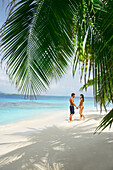 South American couple holding hands on beach, Morrocoy, Venezuela