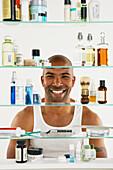 African American man looking in medicine cabinet, Gaithersburg, MD