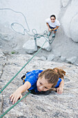 Asian mother and daughter rock climbing, City of Rocks, ID