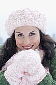 Portrait of Hispanic woman wearing winter clothing, Unknown