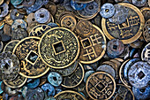 Close up of Vietnamese coins, Hoi An, Vietnam