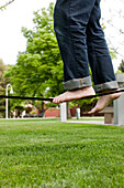 Caucasian man balancing on rope in park, Caldwell, Idaho, USA
