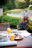 Healthy breakfast on outdoor patio table, Stowe, Vermont, USA