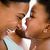 African American mother bonding with baby boy, Jersey City, New Jersey, USA
