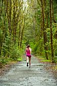 Mixed race woman running on remote path, Bainbridge Island, WA, United States